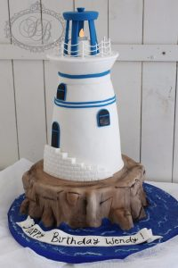 3D blue and white lighthouse cake