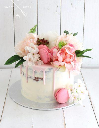 semi naked flowers pink drip cake