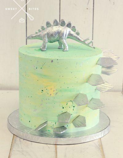 green yellow silver dinosaur stegosaurus cake