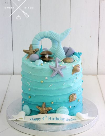 blue ombre under the sea mermaid shell cake