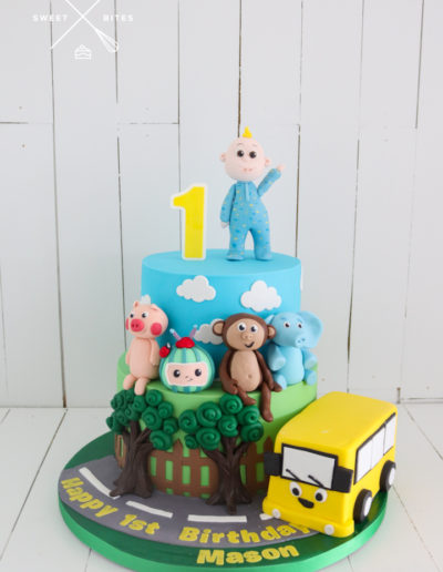 cocomelon baby bus characters 1st birthday 2 tier cake