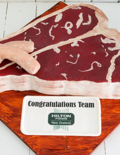 steak t bone cake sausages