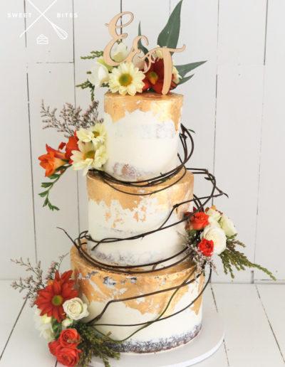 vine country rustic farm gold semi naked wedding cake