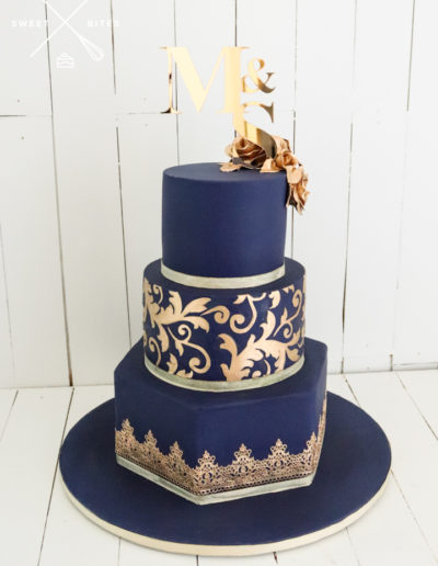 navy gold flourish sugar lace roses hexagon wedding cake
