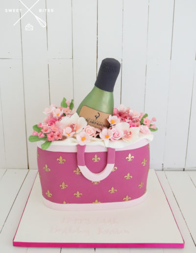 designer handbag pink wine bottle cake