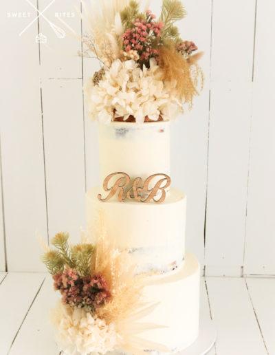 semi naked wedding cake rustic flowers boho country