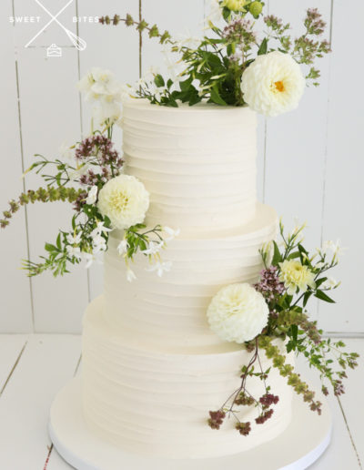3 tier wedding cake linear fresh flowers