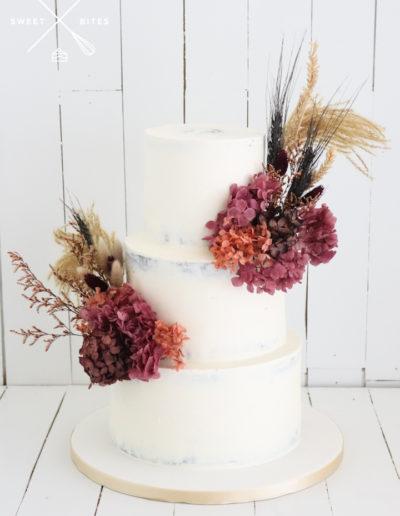 semi naked 3 tier wedding cake dried flowers beach