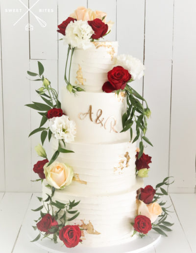4 tier linear texture wedding cake roses gold initials