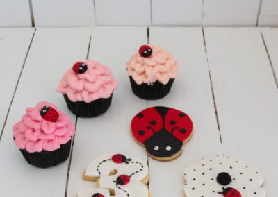 pink cupcakes with ladybird cookies ladybug 3 shaped flower shaped