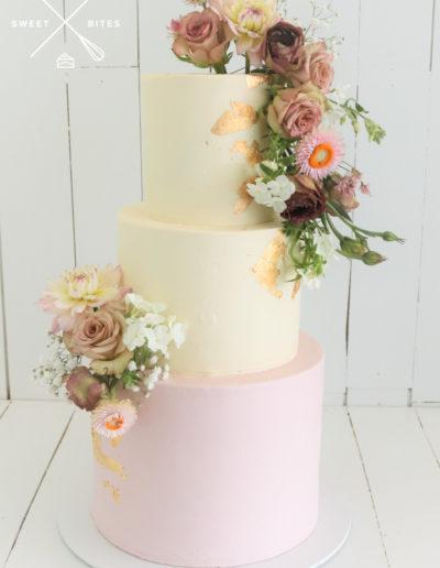 pink gold white wedding cake ganache smooth flowers