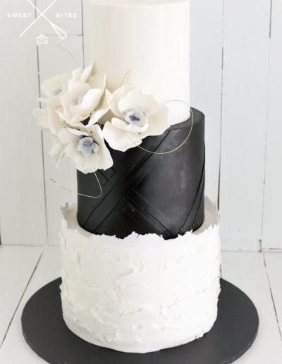 black white wedding cake blue orchid sugar flowers geometric layered texture
