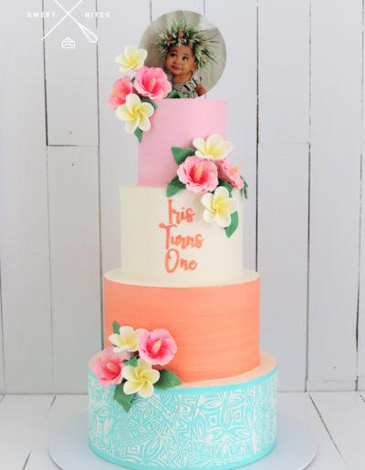 island tropical frangipani cake pastel 4 tier 1st birthday one