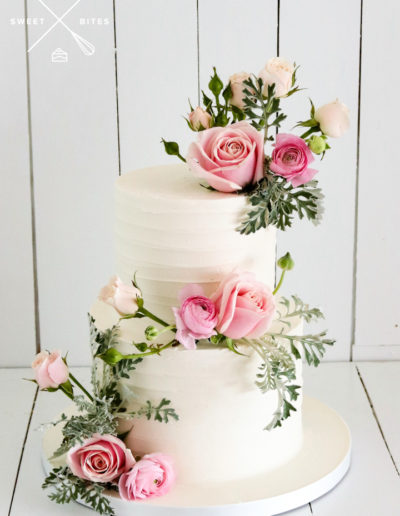 2 tier linear texture wedding cake pink roses