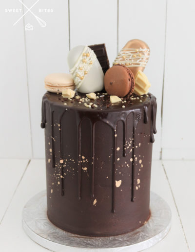 choc cake chocolate drip gold white brown macarons cake popsicles with sprinkles and drizzle choc pieces