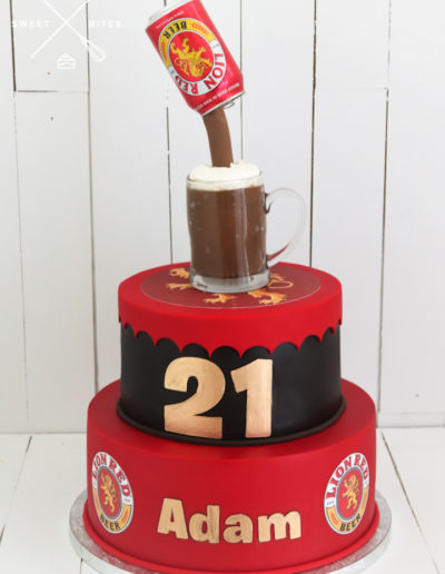 lion red beer 2 tier cake can pouring into cup mug bottle cap