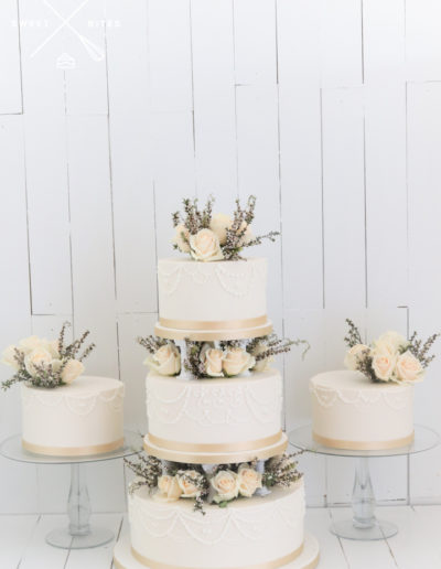 pillar wedding cake roses gifting cakes stand ivory gold tear drop hand piping
