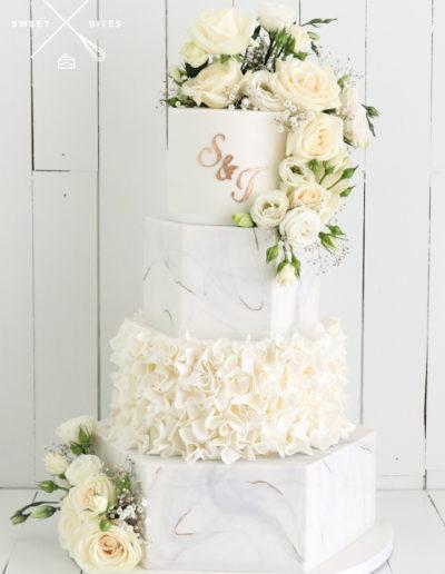 white grey gold marble hexagon wedding cake ruffles