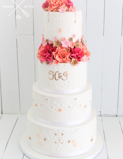 4 tier wedding cake hand piped tear drop piping sugar roses