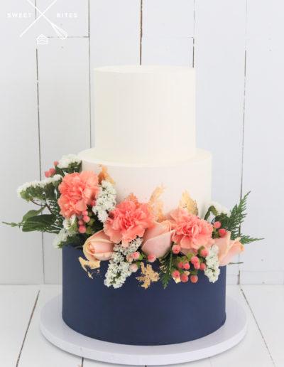 navy blue gold flowers wedding cake 3 tier