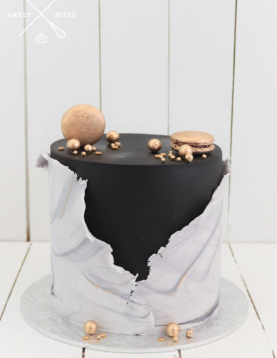 black cake white and grey marble wrap gold macarons